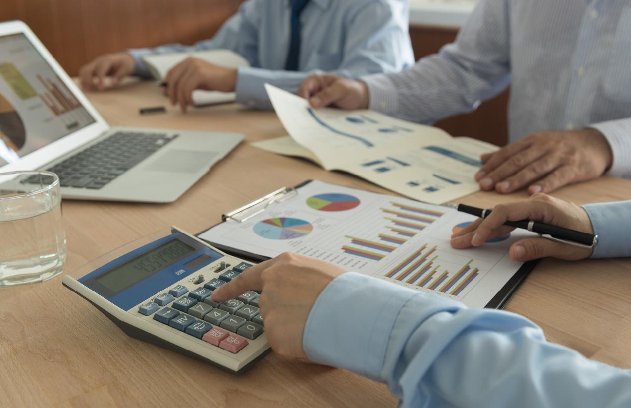 businessmen in bookkeeping meeting