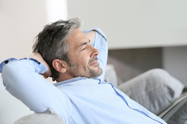 Middle-aged business owner man having a restful moment relaxing bookkeeping