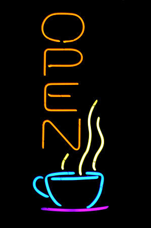 Neon sign in window of coffeehouse